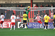 Stevenage FC goalkeeper Jesse Joronen saves Oxford United forward Danny Hylton's attempt on goal during the Sky Bet League 2 match between Stevenage and Oxford United at the Lamex Stadium, Stevenage, England on 31 October 2015. Photo by Jemma Phillips.