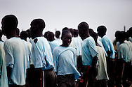 A boy trains to be a policeman at a police training camp in Bentiu.