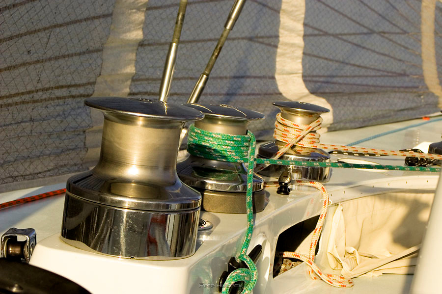 Winches on the deck of the Dolphin sailboat.