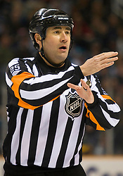 April 16, 2010; San Jose, CA, USA; NHL referee Marc Joannette during the first period of game two between the San Jose Sharks and the Colorado Avalanche in the first round of the 2010 Stanley Cup Playoffs at HP Pavilion.  San Jose defeated Colorado 6-5. Mandatory Credit: Jason O. Watson / US PRESSWIRE