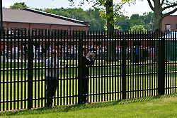 Trump supporters watch protestors through the fence at the Lawrenceville National Guard Armory. as presumptive GOP nominee Donald Trump attends a fundraising event with NJ Gov. Chris Christie at Lawrenceville National Guard Armory in Lawrence Township, NJ