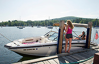 Lillian Fay (Merrill Fay's granddaughter) working at the gas docks in Fay's Boat Yard on Lake Winnipesaukee in Gilford.  (Karen Bobotas/for New England Boating)