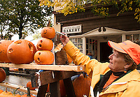 Judy Rogato marks pumpkins for the count during Pumpkin Fest on Saturday afternoon.  (Karen Bobotas/for the Laconia Daily Sun)