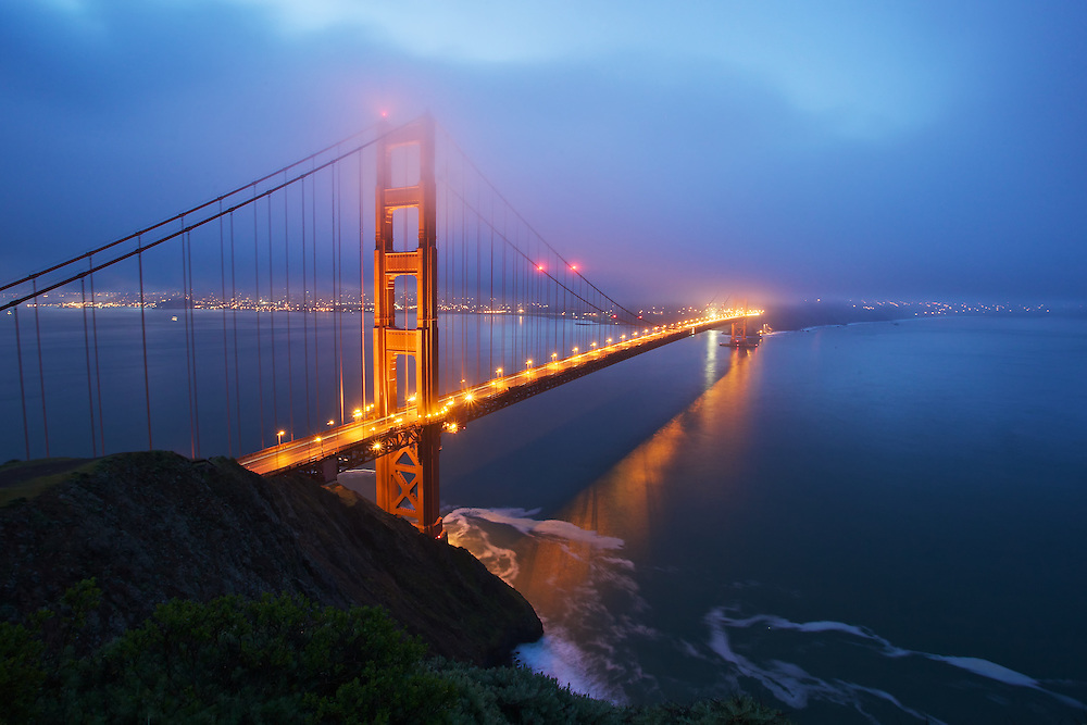 the golden gate bridge during sunrise, shooting from marin towards san francisco