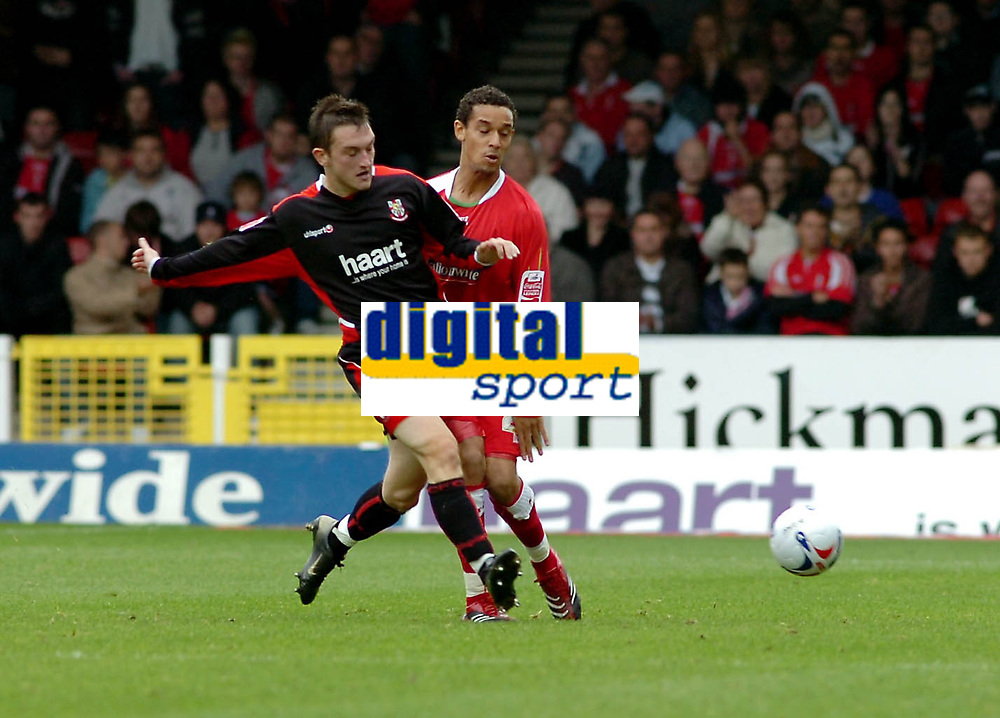Photo: Kevin Poolman.<br />Swindon Town v Lincoln City. Coca Cola League 2. 28/10/2006. Lincoln's Lee Frecklington puts a tackle in on Curtis Weston for Swindon.