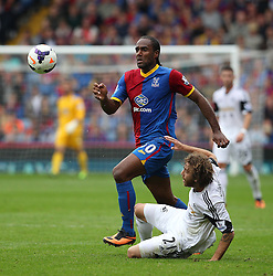 Crystal Palace's Cameron Jerome vies for possession with Swansea City's José Alberto Canas - Photo mandatory by-line: Robin White/JMP - Tel: Mobile: 07966 386802 22/09/2013 - SPORT - FOOTBALL - Selhurst Park - London - Crystal Palace V Swansea City - Barclays Premier League
