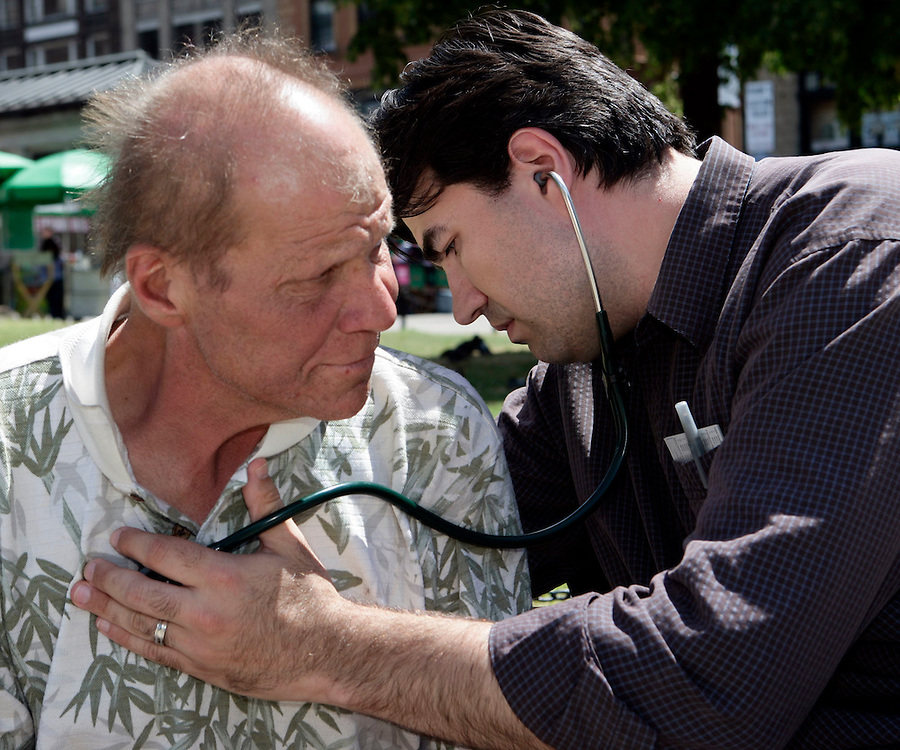 (070210, Boston, MA)..Michael Moreau gets examined by Dr. Patrick Perri in the Boston Common in Boston, MA on July 2, 2010.  Dr. Perri and his associates treat the homeless in Boston, many of whom suffer from mental illness...Staff Photo by Brooks Canaday..Saved in Saturday