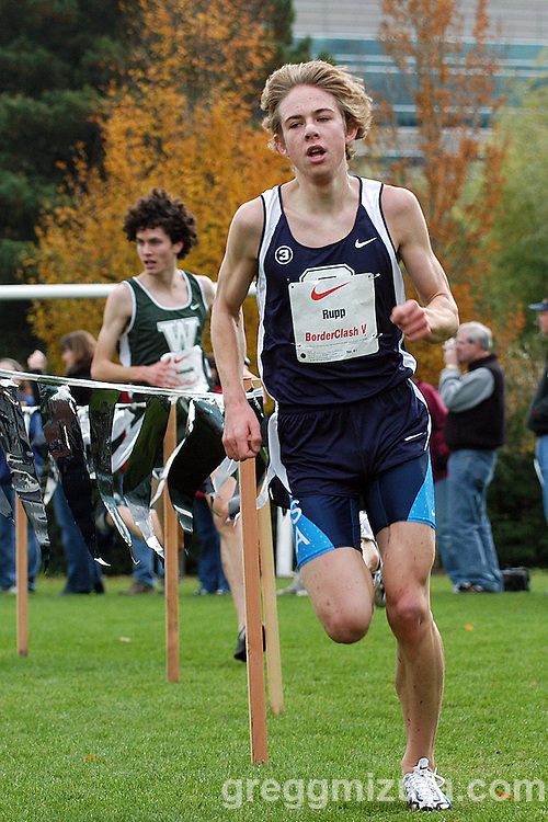 Galen Rupp has the lead as he rounds the final corner to the finish line during the Border Clash at the Nike World Headquarters Campus in Beaverton, Oregon on November 23, 2003.<br /> <br /> Rupp won the race in 13:47.47 and David Kinsella finished second in  13:50.00.