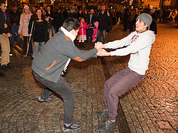 © Licensed to London News Pictures. FILE PICTURE DATED  01/01/2012. New Years Day revellers in Manchester. Two men dance in Manchester's Albert Square, in front of the Town Hall, as the New Year begins. Please see special instructions for usage rates. Photo credit should read Joel Goodman/LNP