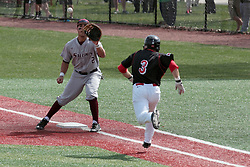 26 April 2014:  Ryan Casillas gets the throw to first as Joe Kelch comes down the line umpired by Grady Smith during an NCAA Division 1 Missouri Valley Conference (MVC) Baseball game between the Southern Illinois Salukis and the Illinois State Redbirds in Duffy Bass Field, Normal IL