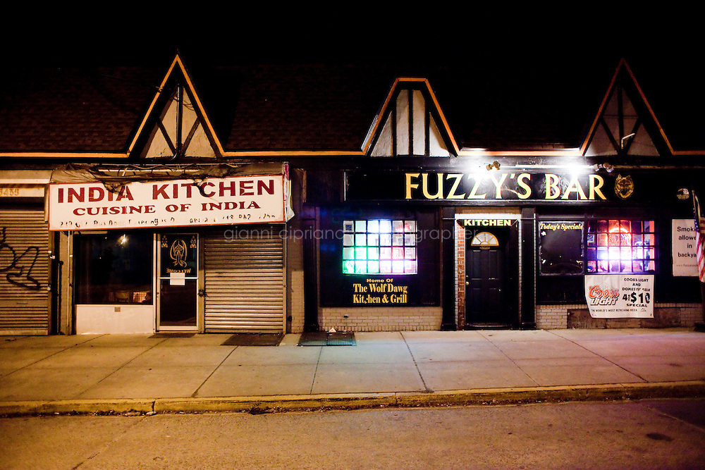 13 February, 2009.Bellerose, Queens, NY. The entrances of the India Kitchen and of Fuzzy's Bar are next door.<br /> <br /> &copy;2009 Gianni Cipriano for The New York Times<br /> cell. +1 646 465 2168 (USA)<br /> cell. +1 328 567 7923 (Italy)<br /> gianni@giannicipriano.com<br /> www.giannicipriano.com