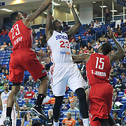 Delaware 87ers Forward Victor Rudd (23) drives towards the basket as Rio Grande Valley Vipers Forward Tony Bishop (23) and Rio Grande Valley Vipers Forward Chris Johnson (15) defends in the first half of a NBA D-league regular season basketball game between the Delaware 87ers and the Rio Grande Valley Vipers (Houston Rockets) Saturday, Dec. 27, 2014 at The Bob Carpenter Sports Convocation Center in Newark, DEL