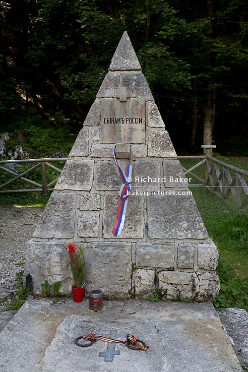 A memorial at the wooden church (Ruska Capela) built by Russian Prisoners of War during WW1, in honour of their comrades who died building the Vrsic Pass road (Ruska Cesta) near kranjska Gora, on 22nd June 2018, in Triglav National Park, Julian Alps, Slovenia.