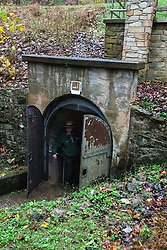 A park ranger stands insides the Carmichael entrance, Mammoth Cave National Park, Kentucky, United States of America