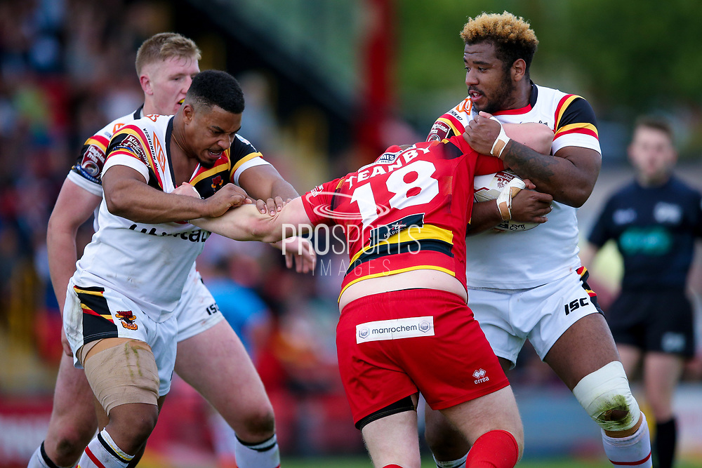 Bradford Bulls prop Jon Magrin (15) and Bradford Bulls loose forward Ross Peltier (17) try to stop Dewsbury Rams Jack Teanby (18)  during the Kingstone Press Championship match between Dewsbury Rams and Bradford Bulls at the Tetley's Stadium, Dewsbury, United Kingdom on 4 June 2017. Photo by Simon Davies.