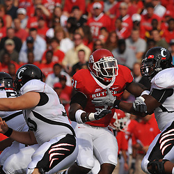 Sep 7, 2009; Piscataway, NJ, USA; Rutgers defensive end George Johnson (31) battles Cincinnati offensive lineman Sam Griffin (66) during the first half of Rutgers game against Cincinnati in NCAA college football at Rutgers Stadium.