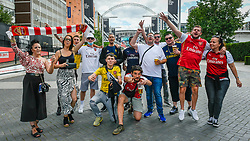 "© Licensed to London News Pictures. 01/08/2020. LONDON, UK. A few Arsenal fans gather in Olympic Way outside Wembley Stadium two hours before the FA Cup Final between Arsenal and Chelsea.  Normally taking place in May, the competition had to be rescheduled due to the coronavirus pandemic.  No spectators or fans will be allowed in the stadium, it will be the first ""Fanless FA Cup Final"".  Photo credit: Stephen Chung/LNP"