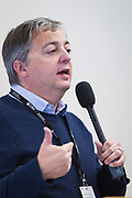 Rob Thomas introduces panelists during the Cap Times Idea Fest 2018 at the Pyle Center in Madison, Wisconsin, Saturday, Sept. 29, 2018.