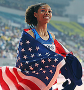 Vashti Cunningham (USA) takes victory lap with United States flag after placing third in the women's high jump at 6-6 3/4 (2.00m) during the IAAF World Athletics Championships, Monday, Sept. 30, 2010, in Doha, Qatar. (Claus Andersen/Image of Sport)