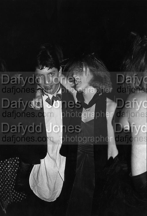 Elinor Greenwood and James Davidson-Houston at Feathers Ball 1986 ONE TIME USE ONLY - DO NOT ARCHIVE  © Copyright Photograph by Dafydd Jones 66 Stockwell Park Rd. London SW9 0DA Tel 020 7733 0108 www.dafjones.com