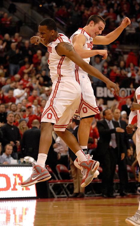 William Buford #44 of the Ohio State Buckeyes celebrates with Aaron Craft #4 during the first half of an NCAA college basketball game on Dec. 28, 2011 at Value City Arena in Columbus, Ohio.
