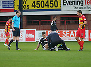 Dundee physio Gerry Docherty treats Dundee&rsquo;s Rhys Healy - Dundee v Partick Thistle, Ladbrokes Premiership at Dens Park<br /> <br />  - &copy; David Young - www.davidyoungphoto.co.uk - email: davidyoungphoto@gmail.com