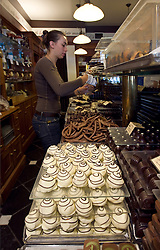 Celine Buisson, fills an order for a customer at The Chocolate Line, gourmet chocolatier, in Bruges, Belgium on Tuesday, Sept. 9, 2008. (Photo © Jock Fistick)