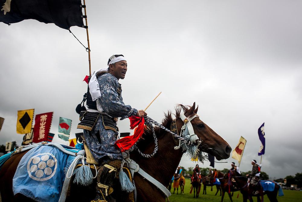 "MINAMISOMA, JAPAN - JULY 24 : A samurai horsemen compete in the Shinki-soudatsusen (sacred flag competition) during the Soma Nomaoi festival at Hibarigahara field on Sunday, July 24, 2016 in Minamisoma, Japan. ""Soma-Nomaoi"" is a traditional festival that recreates a samurai battle scene from more than 1,000 years ago.  (Photo: Richard Atrero de Guzman/NURPhoto)"