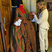 VENICE, ITALY - JANUARY 20:  Choreographer Raffaele Dessi of the historic atelier Pietro Longi examines a 1700 reproduction costume on January 20, 2012 in Venice, Italy. This is one of the busiest periods of the year for the atelier as the next few weeks the streets and canals of Venice will be filled with people attending the carnival,  wearing highly-decorative and imaginative carnival costumes and masks.