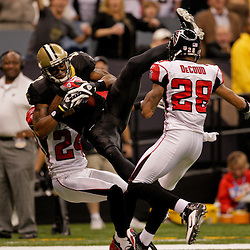 2009 November 02: New Orleans Saints wide receiver Marques Colston (12) catches a touchdown over Atlanta Falcons cornerback Tye Hill (24) and safety Thomas DeCoud (28) during the second quarter at the Louisiana Superdome in New Orleans, Louisiana.