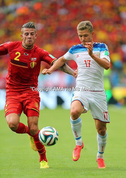 Toby Alderweireld of Belgium and Oleg Shatov of Russia