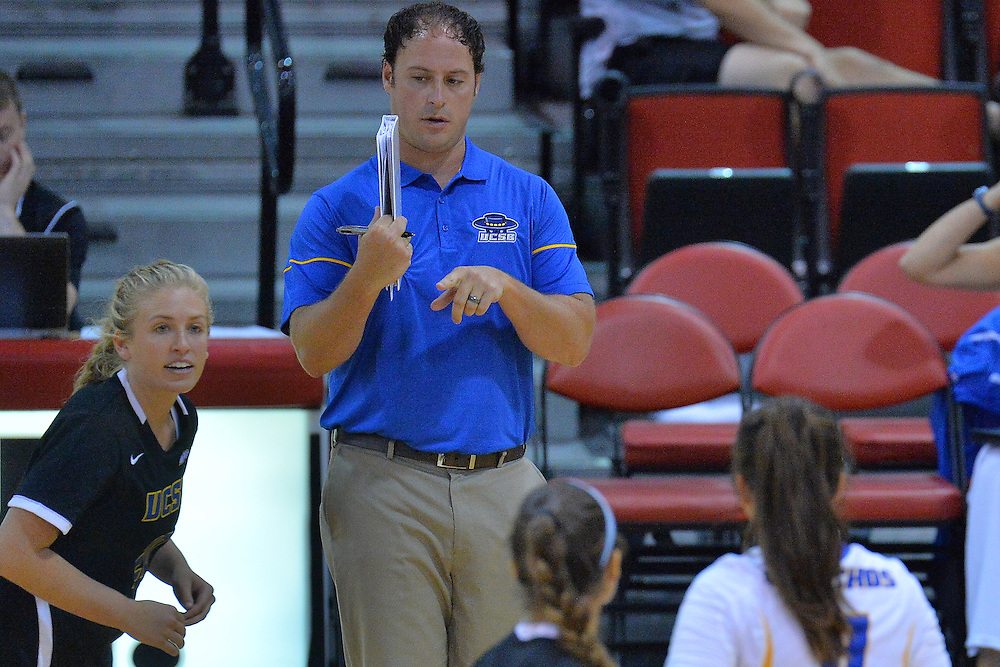 August 26, 2016; Las Vegas, Nev.; UCSB assistant coach Kolby O'Donnell gives his team instructions during a match between the UNLV Lady Rebels and UC Santa Barbara Gauchos. UNLV defeated UCSB 3-0.