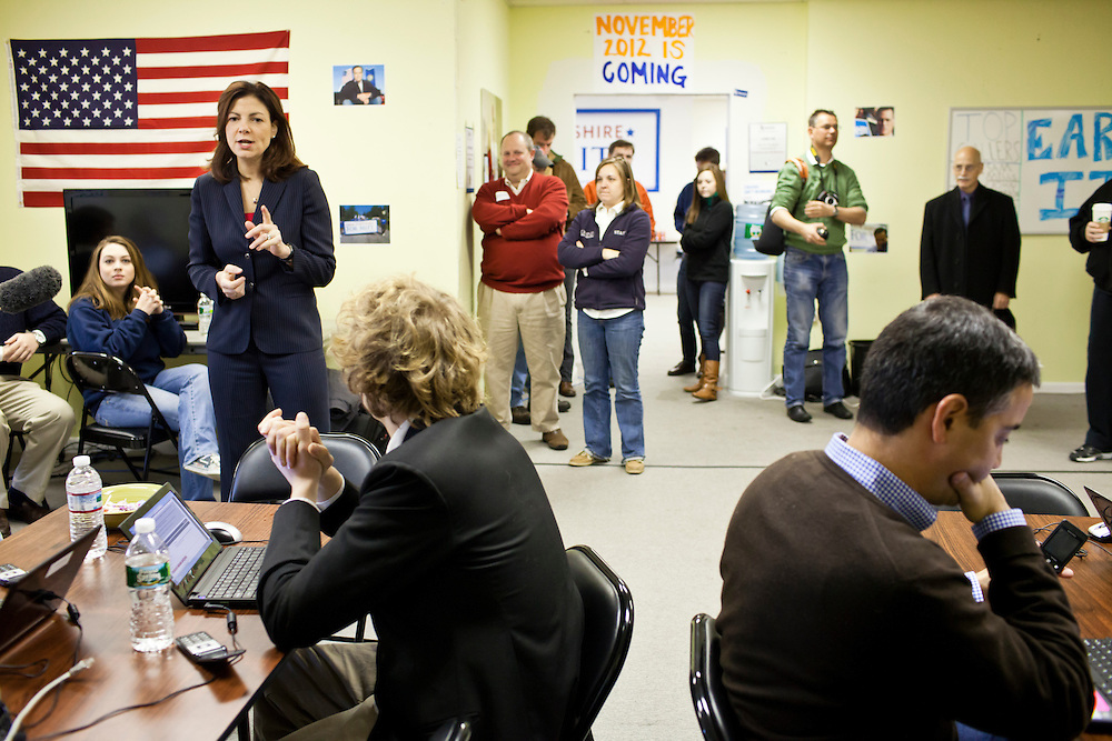 Sen. Kelly Ayotte (R-NH), left, speaks to volunteers and staff at the New Hampshire campaign headquarters of Republican presidential candidate Mitt Romney on Monday, January 9, 2012 in Manchester, NH. Brendan Hoffman for the New York Times
