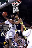 26 November 2005: Dominic James(1), freshman guard for Marquette University takes a shot over Renaldo Balkman (34) in the Marquette Golden Eagle 92-89 overtime victory over the University of South Carolina Gamecocks to win the championship at the Great Alaska Shootout in Anchorage, Alaska