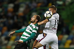 October 22, 2017 - Lisbon, Portugal - Sporting's forward Bas Dost (L) heads for the ball with Chaves's defender Nikola Maras  during Primeira Liga 2017/18 match between Sporting CP vs GD Chaves, in Lisbon, on October 22, 2017. (Credit Image: © Carlos Palma/NurPhoto via ZUMA Press)
