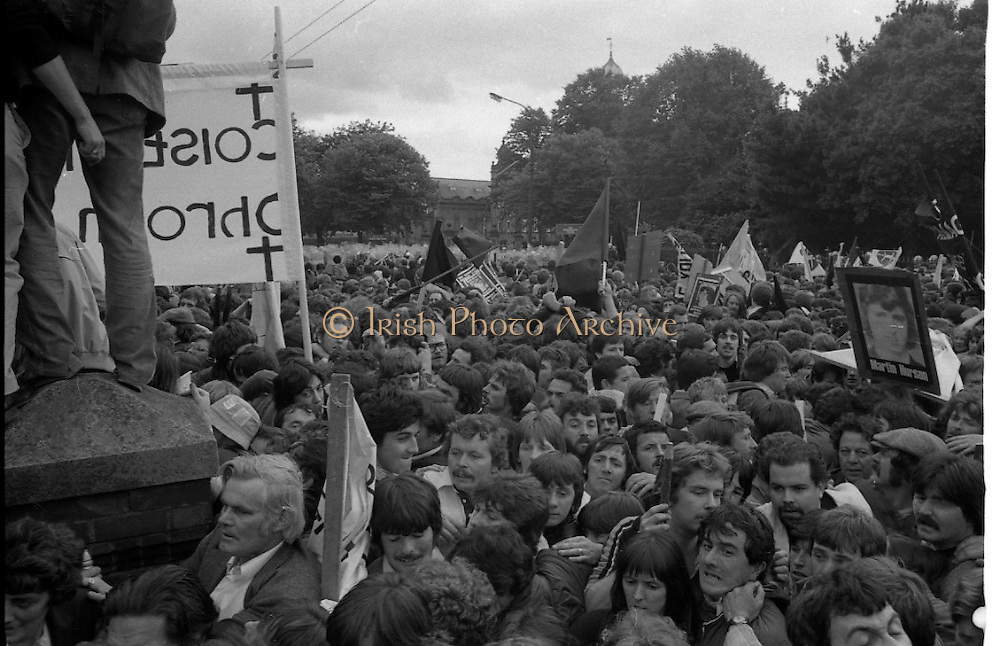 H-Block Protest To British Embassy.  (N86)..1981..18.07.1981..07.18.1981..18th July 1981..A protest march to demonstrate against the H-Blocks in Northern Ireland was held today in Dublin. After the death of several hunger strikers in the H-Blocks feelings were running very high. The protest march was to proceed to the British Embassy in Ballsbridge...As trouble starts to break out at the front of the march the crowd tries to back up but is restricted by the crush of people still arriving at the back of the march.