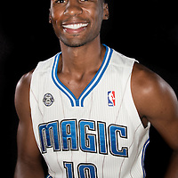 Ronnie Price poses in front of a backdrop during the Orlando Magic media day event at the Amway Arena on Monday, September 30, 2103 in Orlando, Florida. (AP Photo/Alex Menendez)