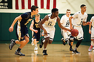 Rice's Ben Shungu (11) dribbles the ball down the court during the boys basketball game between the Essex Hornets and the Rice Green Knights at Rice Memorial high school on Tuesday night December 22, 2015 in South Burlington.(BRIAN JENKINS/for the FREE PRESS)