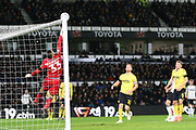 Millwall goalkeeper Bartosz Bialkowski (33) makes a save during the EFL Sky Bet Championship match between Derby County and Millwall at the Pride Park, Derby, England on 14 December 2019.
