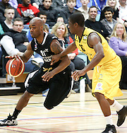 Guildford, England, Sunday 21st March 2010:  Reggie Jackson of Newcastle (21) goes past Paul Peterson (20) of Cheshire during the  BBL Trophy Final between Cheshire Jets and Newcastle Eagles at the Guildford Spectrum, Surrey, UK. Final score Cheshire 95-111 Newcastle.  (photo by Andrew Tobin/SLIK images)