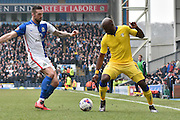 Blackburn Rovers Defender, Grant Hanley and Leeds United Forward, Souleymane Doukara battle for the ball during the Sky Bet Championship match between Blackburn Rovers and Leeds United at Ewood Park, Blackburn, England on 12 March 2016. Photo by Mark Pollitt.