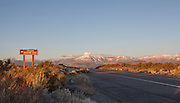 An October sunrise at Sagehen Summit, along highway 120, east of Mono Lake in the eastern Sierra. The peaks of Mt. Lewis, Mt. Gibbs and the Mt. Dana plateau can be seen in the distance.