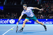 Roger Federer stretches to make a half volley return during the Andy Murray Live event at SSE Hydro, Glasgow, Scotland on 7 November 2017. Photo by Craig Doyle.