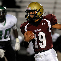 Ashley High School's Travis Lamb rushes against West Brunswick's Damarius Gore Friday November 7, 2014. (Jason A. Frizzelle)