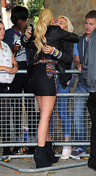 Tulisa Contostavlos wearing a black leather jacket over a short black dress with rainbow pattern and lace up boots, left Live Lounge BBC Radio 1 Studios in Maida Vale to waiting fans. London. UK 28/08/2012<br /><br />BYLINE MUST READ : GOTCHAIMAGES.COM<br /><br />Copyright by © Gotcha Images Ltd. All rights reserved.<br />Usage of this image is conditional upon the acceptance <br />of Gotcha Images Ltd, terms and conditions available at<br />www.gotchaimages.com