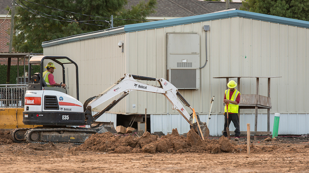 Construction crews work on the new Condit Elementary School, August 19, 2015.