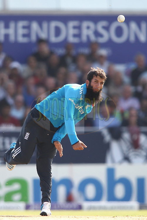 Moeen Ali of England sends down a delivery during the 5th One Day International ( ODI ) match between England and India held at Headingley Cricket Ground in Leeds, England on the 5th September 2014<br /> <br /> Photo by Shaun Roy / SPORTZPICS/ BCCI