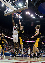 Virginia Cavaliers center Tunji Soroye (21) shoots over Albany Great Danes forward Brent Wilson (34).  The #4 seed Virginia Cavaliers defeated the #13 seed Albany Great Danes 84-57 in the first round of the South Region Men's NCAA Tournament in Columbus, OH on March 16, 2007.