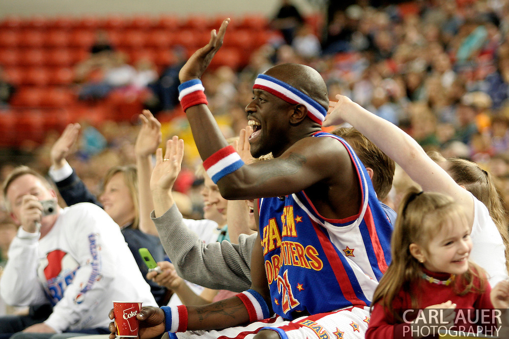 """04 May 2006: Kevin """"Special K"""" Daley waves to his team mates while sitting on a fan at the Harlem Globetrotters vs the New York Nationals at the Sulivan Arena in Anchorage Alaska during their 80th Anniversary World Tour.  This is the first time in 10 years that the Trotters have visited Alaska."""