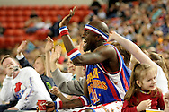 "04 May 2006: Kevin ""Special K"" Daley waves to his team mates while sitting on a fan at the Harlem Globetrotters vs the New York Nationals at the Sulivan Arena in Anchorage Alaska during their 80th Anniversary World Tour.  This is the first time in 10 years that the Trotters have visited Alaska."